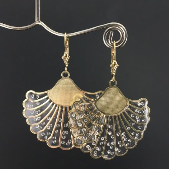 Boucles d'oreilles «Zoé» dorées inclusion zircons transparents.