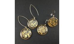 Boucles d'oreilles feuille d'or en suspension cercles dorés