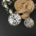 Pendentif fragments de feuilles d'argent en suspension cercle doré