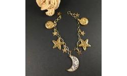 Bracelet breloques pampilles lune, étoiles dorées, feuille d'or et feuille d'argent